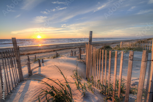 Fototapeta Sunrise as seen from the sand dunes at the Outer Banks, NC around Corolla Beach in September, 2014