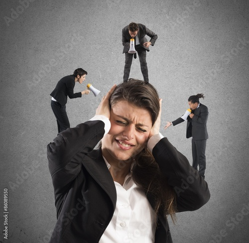 Businesswoman annoyed by screams Fototapeta