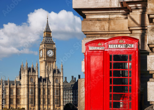 English red telephone booths with Big Ben in London, UK #86269323