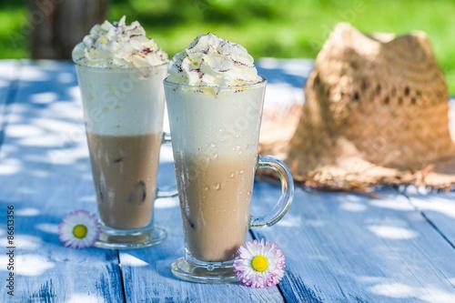 Delicious latte in sunny garden Poster Mural XXL