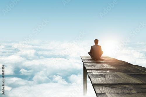 businessman sitting on pier