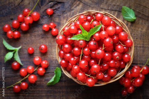 Wallpaper Mural Fresh Red currants in a wiccker bowl on dark rustic wooden background