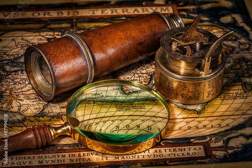 Valokuvatapetti Old vintage compass on ancient map