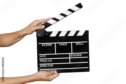 Fotografiet young man with a traditional wooden clapperboard