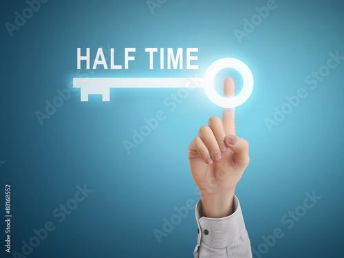 Fototapeta male hand pressing half time key button