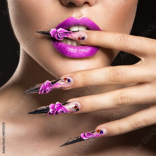 Fotografering Beautiful girl in mask with long nails and sensual lips. Beauty