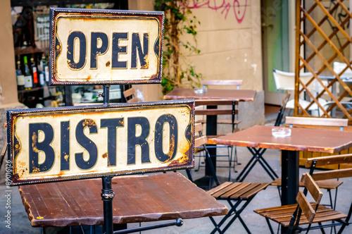 Vászonkép Open bistro sign at the empty caffe terrace