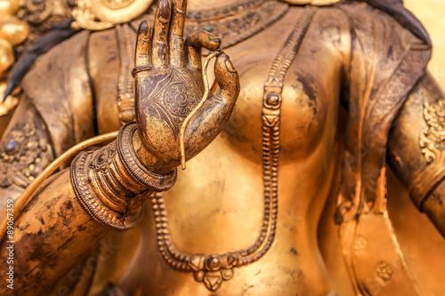 Fotografie, Obraz Bronze statue closeup, Nepal