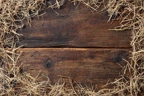Valokuvatapetti Frame from straw on vintage wooden board