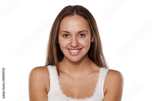 Wallpaper Mural smiling young woman without make-up, looking at the camera