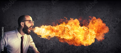 Fotografia angry and furious announcement - businessman spitting fire