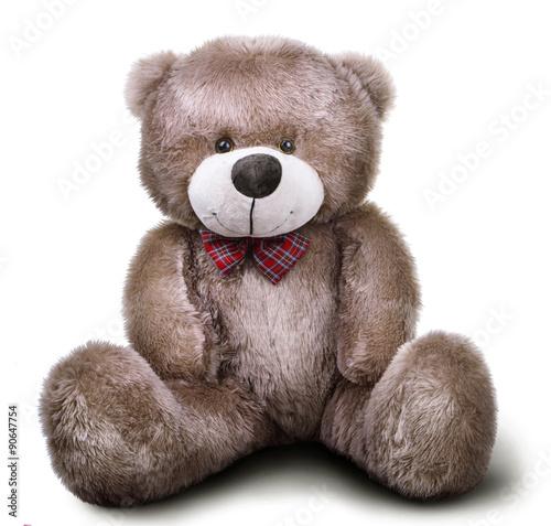 Toy soft teddy bear with bow