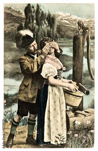 Funny flirting couple in typical bavarian dress dirndl Fototapete