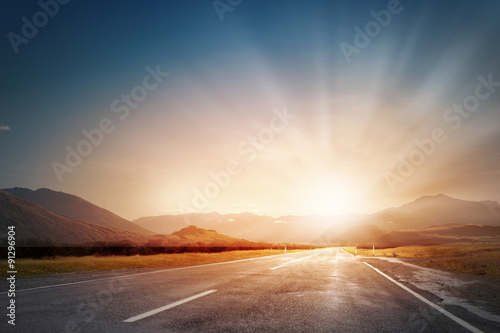 Obraz na płótnie Zachód słońca nad drogą