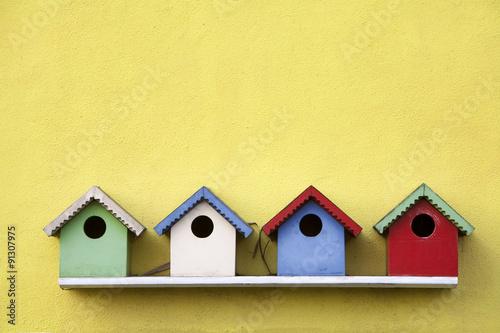 Canvas Print Street of birdhouses