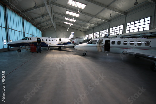 Business jets under the roof Fototapeta