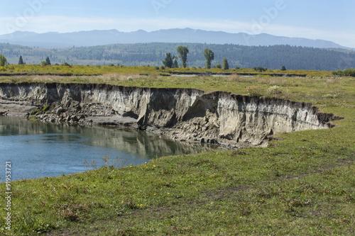 Bank erosion, pasture along Buffalo Fork River, Moran, Wyoming. Fototapet