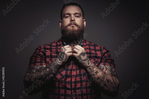 Fototapeta Brutal man with beard and tattoes