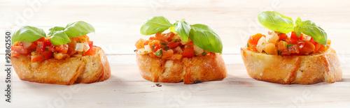 Obraz na płótnie Tomato Bruschetta on Baguette with Fresh Basil