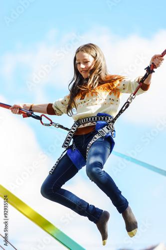 Slika na platnu Teenage girl jumping with bungie