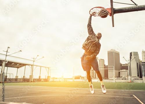 Canvas Print Street basketball player performing power slum dunk