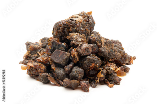 Photo Pile of Organic Indian bdellium or Guggul resin (Commiphora wightii) isolated on white background