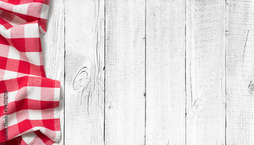 Stampa su Tela red picnic tablecloth on white wood table background