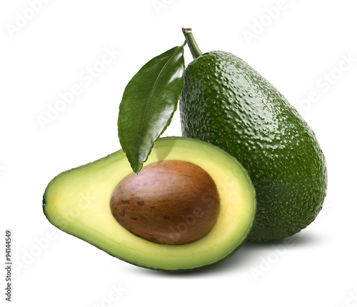 Whole avocado leaves half cut isolated on white background