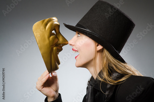 Fotografia Woman with mask in funny concept