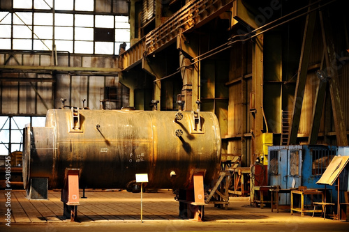 Industrial tank inside old factory