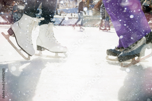 Fototapeta Closeup skating shoes ice skating outdoor at ice rink