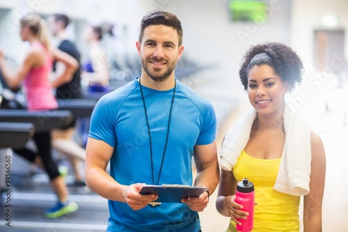 Trainer and client smiling at camera Fototapet