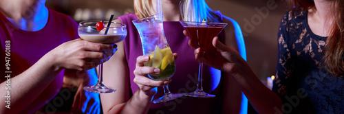 Three female friends toasting