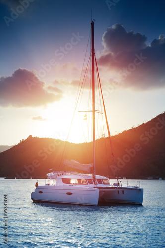 Beautiful view to catamaran in Seychelles bay at sunset Fototapeta