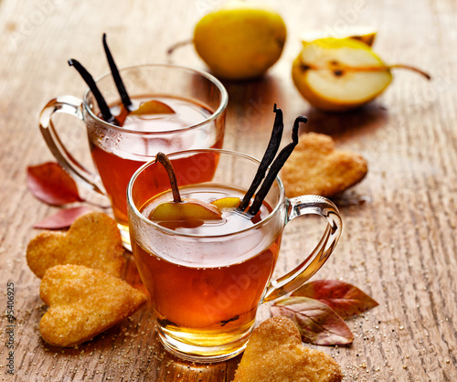 Hot fruit tea with ripe pears and vanilla, delicious and aromatic #95406925