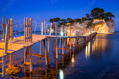 Fotografie, Obraz Hanging bridge to the island at night, Zakhynthos in Greece