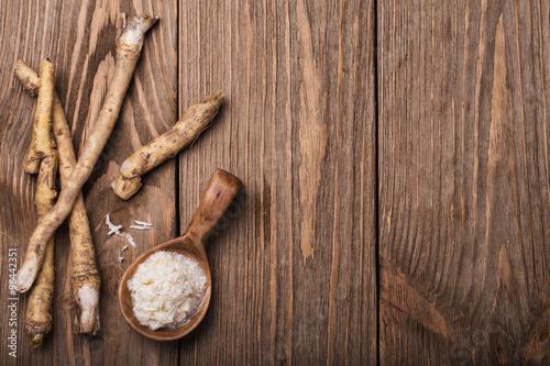 Valokuvatapetti Seasoning of grated horseradish with space for text