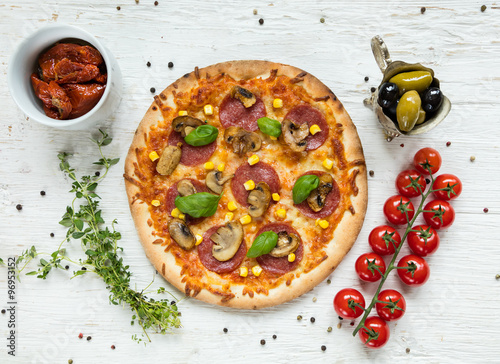 Delicious italian pizza served on wooden table #96953152