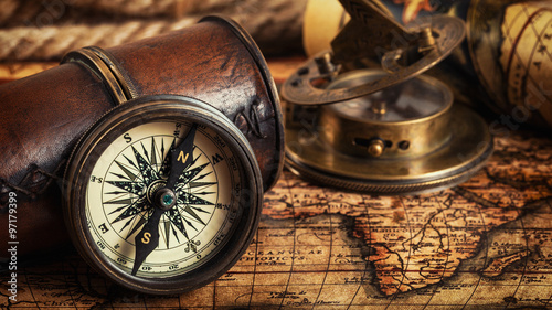 Old vintage compass on ancient map #97179399