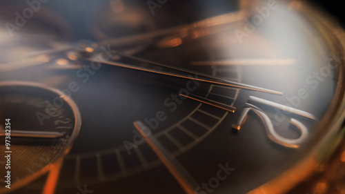 Beautiful ladies golden watch, arrow points at twelve o`clock, large depth of field effect.