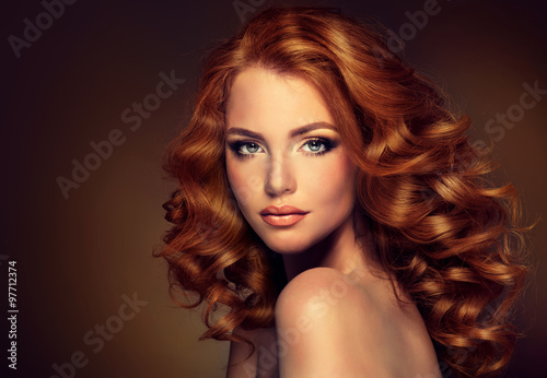 Fotografering Girl model with long red wavy hair