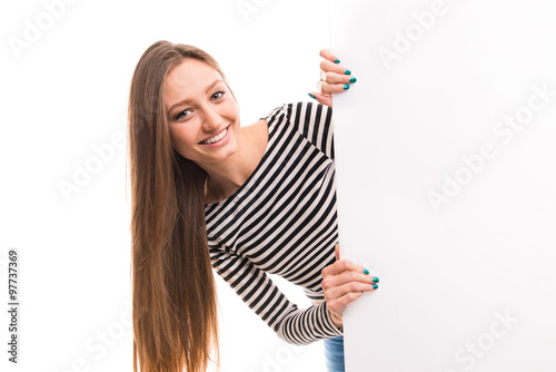 Fotografia Young long-haired girl standing near big poster