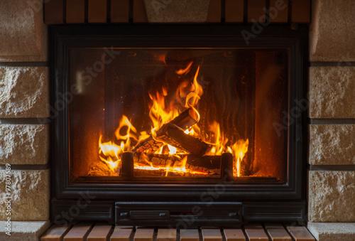 Fototapeta close up of burning fireplace at home