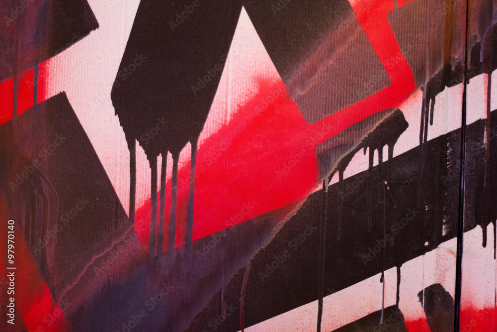 Red on black graffiti detail