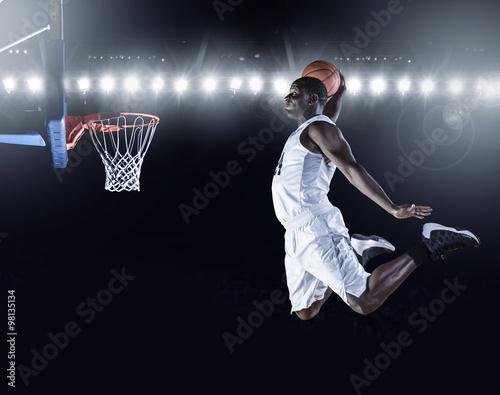 Canvas Print Basketball Player scoring a slam dunk basket