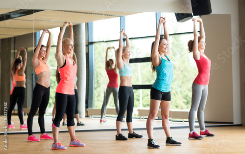 group of women working out in gym #98177360