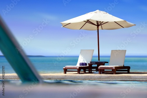 Fototapeta Poolside view near the beach with blue sky