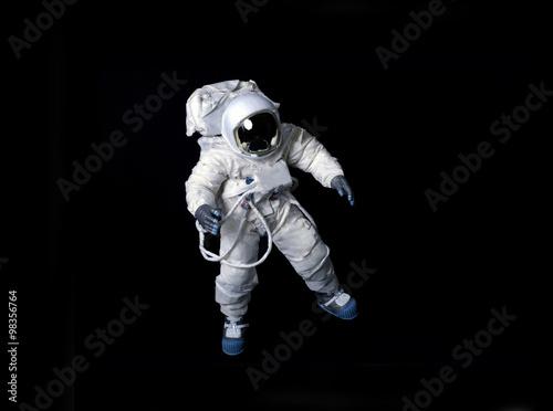 Fotografija Astronaut floating against a black background.