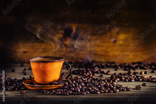 Coffee. Cup of black coffee and spilled coffee beans. Coffee break