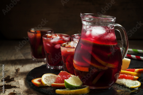 Obraz na płótnie Sangria in pitcher with slices of fruit and ice, selective focus